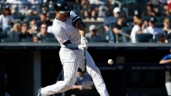New York Yankees' Giancarlo Stanton hits a home run against the Toronto Blue Jays during the sixth inning of the team's baseball game, Saturday, Sept. 21, 2019, in New York. (AP Photo/Michael Owens)