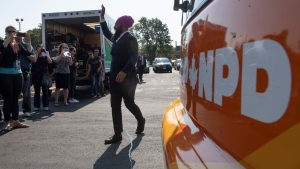 NDP Leader Jagmeet Singh swaves as he arrives at a campaign event in Essex, Ont., Friday, Sept. 20, 2019. THE CANADIAN PRESS/Adrian Wyld