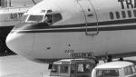 FILE - In this Wednesday, June 19, 1985 file photo, a hijacker points a weapon toward an ABC news media crew from the window of the cockpit of the Trans World Airlines jet as the American television crew approaches the jet for an interview at Beirut International Airport, Lebanon. Greek police said Saturday Sept. 21, 2019, they have arrested a suspect in the 1985 hijacking of a flight from Athens that included the slaying of an American. (AP Photo/Herve Merliac, File)