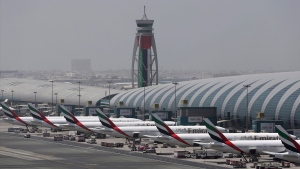 In this April 20, 2017, file photo, Emirates planes are parked at the Dubai International Airport in Dubai, United Arab Emirates. (AP Photo/Kamran Jebreili, File)