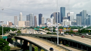 Cars travel along a highway with the skyline of downtown Houston in the background on May 20, 2010. THE CANADIAN PRESS/AP-Houston Chronicle, Michael Paulsen