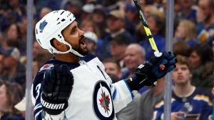 Winnipeg Jets' Dustin Byfuglien celebrates after scoring during the third period in Game 3 of an NHL first-round hockey playoff series against the St. Louis Blues Sunday, April 14, 2019, in St. Louis. Veteran defenceman Byfuglien has been suspended without pay by the Jets in a move that frees up space under the salary cap. (THE CANADIAN PRESS/AP/Jeff Roberson)