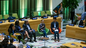 Swedish environmental activist Greta Thunberg, center, speaks to guests next to U.N. Secretary-General Antonio Guterres, center left, during the Youth Climate Summit at United Nations headquarters, Saturday, Sept. 21, 2019.  (AP Photo/Eduardo Munoz Alvarez)