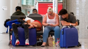 British passengers wait for news on cancelled Thomas Cook flights at Palma de Mallorca airport on Monday Sept. 23, 2019. (AP Photo/Francisco Ubilla)