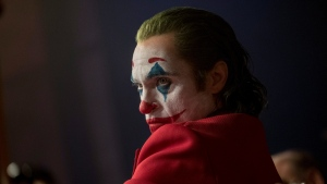 "This image released by Warner Bros. Pictures shows Joaquin Phoenix in a scene from ""Joker,"" in theaters on Oct. 4. Alarmed by violence depicted in a trailer for the upcoming movie ""Joker,"" some relatives of victims of the 2012 Aurora movie theater shooting asked distributor Warner Bros. on Tuesday to commit to gun control causes. Twelve people were killed in the suburban Denver theater during a midnight showing of the Batman film, ""The Dark Knight Rises,"" also distributed by Warner Bros. (Niko Tavernise/Warner Bros. Pictures via AP)"