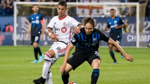 Montreal Impact Lassi Lappalainen (21) controls the ball way from Toronto FC Erickson Gallardo (9) during first half of the first leg of the Canadian Championship Final action in Montreal on Wednesday, September 18, 2019. THE CANADIAN PRESS/Paul Chiasson