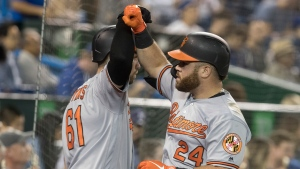 Baltimore Orioles DJ Stewart, right, is greeted by teammate Austin Wynns after Stewart hit a two-run home run against the Toronto Blue Jays in the sixth inning of their American League MLB baseball game in Toronto on Tuesday, September 24, 2019. THE CANADIAN PRESS/Fred Thornhill