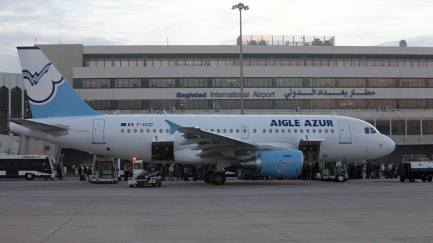 France's Aigle Azur airlines plane is docked at a ramp in Baghdad, Iraq, Sunday, Oct. 31, 2010. The French airline has landed in Baghdad international airport, becoming one of the first passenger carriers to fly into the capital direct from western Europe since the Gulf War. (AP Photo/Karim Kadim)