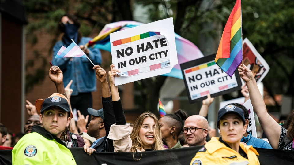 People rally for unity in response to an anti-LGBTQ group's planned march through the city's gay village, in Toronto, on Saturday, Sept., 28, 2019. THE CANADIAN PRESS/Christopher Katsarov