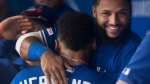 Toronto Blue Jays' Teoscar Hernandez gets a hug from teammate Richard Urena after he hit a home run against the Tampa Bay Rays in their American League MLB baseball game in Toronto Saturday September 28, 2019. THE CANADIAN PRESS/Fred Thornhill