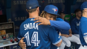 Toronto Blue Jays Vladimir Guerrero Jr. embraces team mate Justin Smoak on this the last day of the season prior to the start of their American League MLB baseball game against the Tampa Bay Rays in Toronto Sunday September 29, 2019. THE CANADIAN PRESS/Fred Thornhill