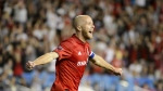Toronto FC midfielder Michael Bradley (4) celebrates after teammate Justin Morrow (2) scored during second half MLS Soccer action against the Montreal Impact, in Toronto, on Saturday, Aug. 24, 2019. (FILE/THE CANADIAN PRESS/Andrew Lahodynskyj)