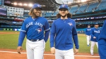 Toronto Blue Jays' Vladimir Guerrero Jr. and Bo Bichette leave the field at the end of their American League MLB baseball game against the Tampa Bay Rays in Toronto on Sunday, September 29, 2019. THE CANADIAN PRESS/Fred Thornhill