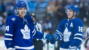 Toronto Maple Leafs centre Auston Matthews (34) and teammate Mitchell Marner (16) laugh after defeating the Ottawa Senators in third period NHL hockey action in Toronto on Wednesday, Oct. 2, 2019. THE CANADIAN PRESS/Nathan Denette