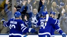 Toronto Maple Leafs centre Auston Matthews (34) celebrates his goal with teammates John Tavares (91) and Andreas Johnsson (18) during second period NHL hockey action against the Ottawa Senators, in Toronto on Wednesday, October 2, 2019. THE CANADIAN PRESS/Nathan Denette