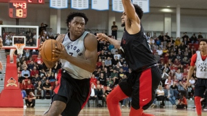 Toronto Raptors' OG Anunoby, left, makes his way around Oshae Brissett during an intra-squad scrimmage at the Raptors training camp practice in Quebec City, Thursday, Oct. 3, 2019. THE CANADIAN PRESS/Jacques Boissinot