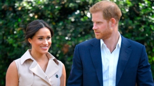 In this Wednesday Oct. 2, 2019 file photo, Britain's Harry and Meghan, Duchess of Sussex arrive at the Creative Industries and Business Reception at the British High Commissioner's residence, in Johannesburg, where they will meet with representatives of the British and South African business communities, including local youth entrepreneurs. British media reports said Friday Oct. 4, 2019 that Britian's Prince Harry has launched legal proceedings at the High Court against two British tabloid newspapers over alleged phone hacking. (Dominic Lipinski/Pool via AP, File)