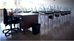 A empty teacher's desk is pictured in an empty classroom at Mcgee Secondary school in Vancouver on Sept. 5, 2014. (THE CANADIAN PRESS/Jonathan Hayward)