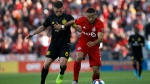 Toronto FC defender Justin Morrow (2) and Columbus Crew SC midfielder Will Trapp (6) vie for the ball during first half of MLS soccer action at BMO Field in Toronto, Sunday, Oct. 6, 2019. THE CANADIAN PRESS/ Cole Burston