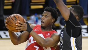 Toronto Raptors guard Kyle Lowry (7) gets off a shot in front of Golden State Warriors centre Kevon Looney (5) during first half basketball action in Game 6 of the NBA Finals in Oakland, Calif. on Thursday, June 13, 2019. THE CANADIAN PRESS/Frank Gunn