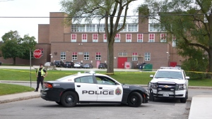 Police investigate after a 14-year-old Devan Bracci-Selvey was killed in an assault outside Sir Winston Churchill Secondary School on Oct. 7, 2019. (CTV News Toronto/Ricardo Alfonso)