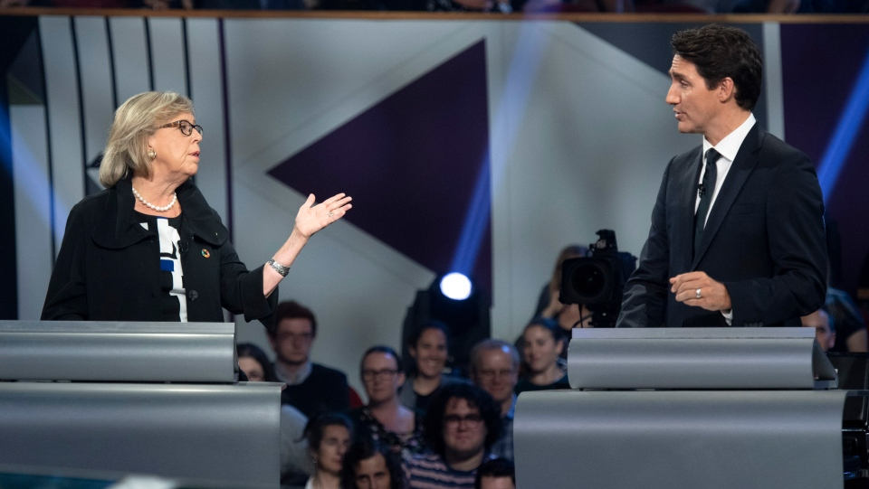 Green Party leader Elizabeth May, left, and Liberal leader Justin Trudeau gesture to each other as they both respond during the Federal leaders debate in Gatineau, Que. on Monday, October 7, 2019. THE CANADIAN PRESS/Justin Tang