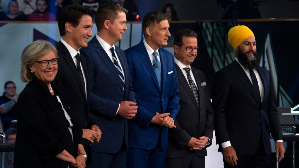 Federal party leaders Green Party leader Elizabeth May, Liberal leader Justin Trudeau, Conservative leader Andrew Scheer, People's Party of Canada leader Maxime Bernier, Bloc Quebecois leader Yves-Francois Blanchet and NDP leader Jagmeet Singh pose for a photograph before the Federal leaders debate in Gatineau, Que. on Monday, October 7, 2019. THE CANADIAN PRESS/Sean Kilpatrick