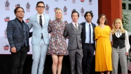 """FILE - In this May 1, 2019, file photo, Johnny Galecki, from left, Jim Parsons, Kaley Cuoco, Simon Helberg, Kunal Nayyar, Mayim Bialik and Melissa Rauch, cast members of the TV series """"The Big Bang Theory,"""" pose at a hand and footprint ceremony at the TCL Chinese Theatre in Los Angeles. """"The Big Bang Theory"""" made its way into the annals of the Nobel Prizes in real life. (Photo by Willy Sanjuan/Invision/AP, File)"""