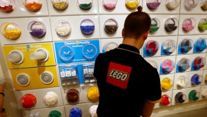 FILE- In this April 5, 2016 file photo, an employee sorts Legos in the the new LEGO flagship store unveiled as part of the new Les Halles shopping mall during the press visit in Paris. The Danish toymaker is testing a way for customers to ship their unwanted bricks back and get them into the hands of other kids. (AP Photo/Francois Mori, File)