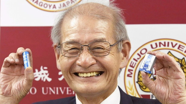 """In this Sept. 28, 2017, photo, Akira Yoshino poses with lithium batteries in Nagoya, central Japan. The 2019 Nobel Prize in Chemistry on Wednesday Oct. 9, 2019, has been awarded to John B. Goodenough, M. Stanley Whittingham and Akira Yoshino """"for the development of lithium-ion batteries."""" (Yoshiaki Sakamoto/Kyodo News via AP)"""