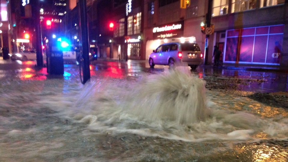 Police are working to repair a water main break on Yonge Street near the Eaton Centre. (Cam Woolley/ CP24)