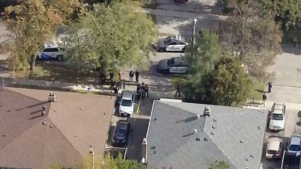 Police are seen outside a Scarborough home after a serious stabbing incident on Oct. 10, 2019. (Chopper 24)
