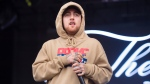 FILE - In this Oct. 2, 2016 file photo, Mac Miller performs at the 2016 The Meadows Music and Arts Festivals at Citi Field in Flushing, New York. Three men arrested during the investigation into rapper Miller's deadly overdose last year have now been charged with providing the drugs that killed him, U.S. prosecutors said Wednesday, Oct. 9, 2019. A grand jury indictment that was unsealed in Los Angeles accuses the men of conspiring and distributing cocaine and oxycodone pills laced with fentanyl that caused Miller's death in September 2018. (Photo by Scott Roth/Invision/AP, File)
