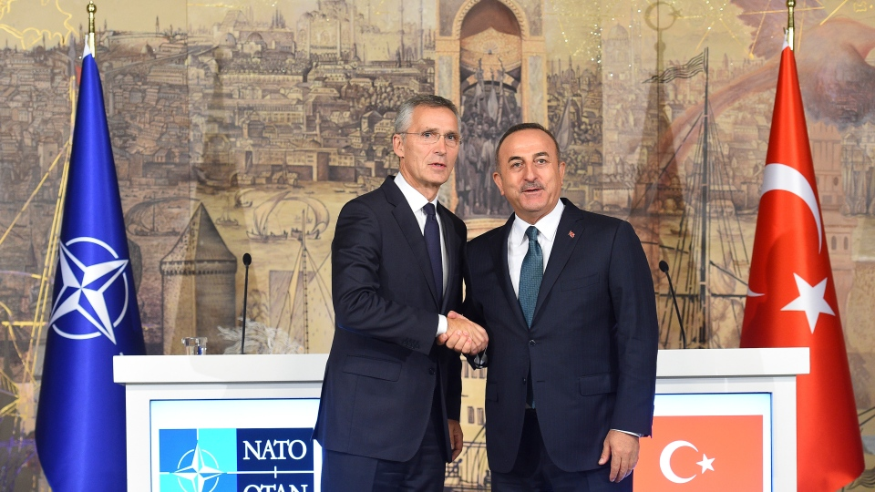Turkish Foreign Minister Mevlut Cavusoglu, right, and NATO Secretary General Jens Stoltenberg shake hands after a joint press conference, in Istanbul, Friday, Oct. 11, 2019. NATO's secretary-general says he acknowledges Turkey's legitimate security concerns but has urged Ankara to exercise restraint in its incursion into northeast Syria. (AP Photo/Akin Celiktas)