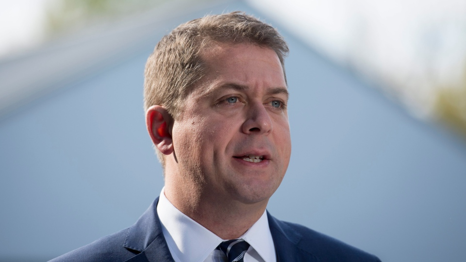 Conservative leader Andrew Scheer makes a morning announcement at the Canada/USA boarder on Roxham road during a campaign stop in Lacolle, Que. Wednesday, October 9, 2019. THE CANADIAN PRESS/Jonathan Hayward