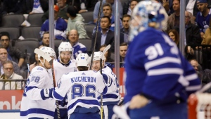 Tampa Bay Lightning right wing Nikita Kucherov (86) celebrates his goal with teammates defenceman Mikhail Sergachev (98), defenceman Victor Hedman (77), and centre Steven Stamkos (91) during the first period in their NHL hockey game in Toronto, Thursday, Oct. 10, 2019. THE CANADIAN PRESS/Cole Burston