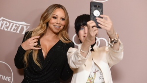 Mariah Carey, left, and Diane Warren take a selfie at Variety's Power of Women on Friday, Oct. 11, 2019, at the Beverly Wilshire hotel in Beverly Hills, Calif. (Photo by Jordan Strauss/Invision/AP)