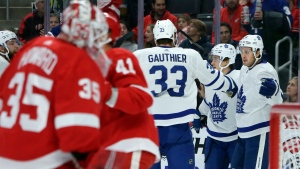 Toronto Maple Leafs center Nicholas Shore, right, celebrates with center Frederik Gauthier (33) and left wing Dmytro Timashov, center, of Ukraine, after scoring against the Detroit Red Wings during the first period of an NHL hockey game, Saturday, Oct. 12, 2019, in Detroit. (AP Photo/Duane Burleson)