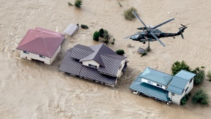 A Japan Self-Defense Force helicopter hovers above submerged residential area after an embankment of the Chikuma River broke because of Typhoon Hagibis, in Nagano, central Japan, Sunday, Oct. 13, 2019. Rescue efforts for people stranded in flooded areas are in full force after a powerful typhoon dashed heavy rainfall and winds through a widespread area of Japan, including Tokyo.(Yohei Kanasashi/Kyodo News via AP)
