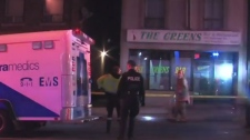 Two women are in serious condition after being shot in front of a bar