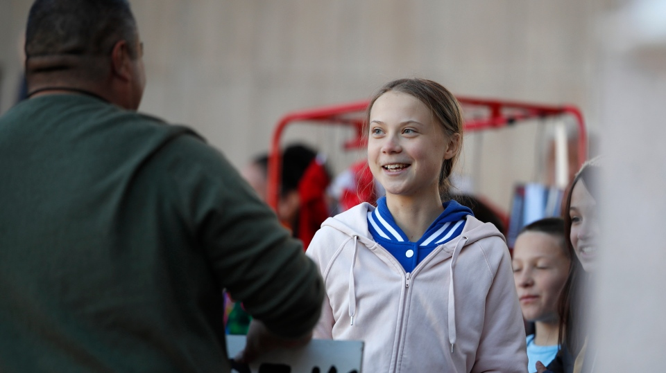 Swedish climate activist Greta Thunberg greets a well-wisher after she spoke to several thousand people at a climate strike rally Friday, Oct. 11, 2019, in Denver. The rally was staged in Denver's Civic Center Park. (AP Photo/David Zalubowski)