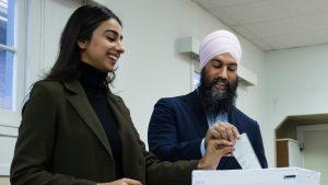 NDP leader Jagmeet Singh, right, and his wife Gurkiran Kaur, left, cast their ballots at an advanced polling station in his Burnaby South riding during a campaign stop in Burnaby, B.C., on Sunday, October 13, 2019. THE CANADIAN PRESS/Nathan Denette