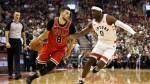 Chicago Bulls guard Zach LaVine (8) drives against Toronto Raptors guard Terence Davis (0) during the first half of their NBA basketball game in Toronto, Sunday, Oct. 13, 2019. THE CANADIAN PRESS/ Cole Burston