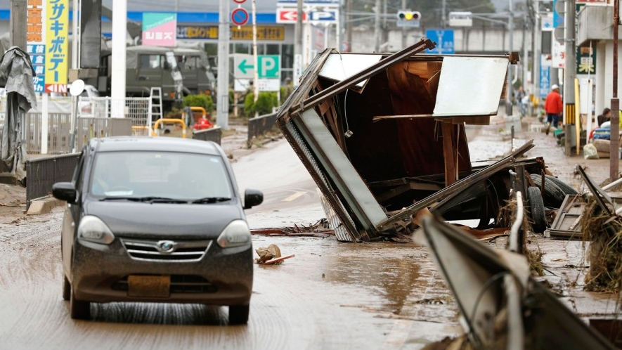 Debris caused by Typhoon Hagibis are left on a street in Motomiya, Fukushima prefecture, Japan Monday, Oct. 14, 2019. Rescue crew dug through mudslides and searched near flooded rivers for missing people Monday after the typhoon caused serious damage in central and northern Japan.  KYODO NEWS/AP