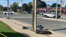 The corner of Pharmacy Avenue and Ellesmere Road shortly after three pedestrians were struck by a vehicle while standing on the curb. (CP24)