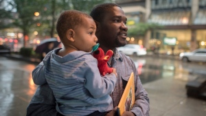 Alishia Liolli's husband Cialin Dany holds their child Evan, after attending a memorial service for Liolli, who died in hurricane Dorian in the Bahamas, in Toronto on Tuesday, October 1, 2019. THE CANADIAN PRESS/ Tijana Martin