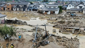 This photo shows a flooded area in Nagano, central Japan following Typhoon Hagibis , Monday, Oct. 14, 2019.  (Kyodo News via AP)