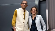 Esther Duflo, left, and Abhijit Banerjee stand together following a news conference at Massachusetts Institute of Technology in Cambridge, Mass., Monday, Oct. 14, 2019. Banerjee and Duflo, along with Harvard's Michael Kremer, were awarded the 2019 Nobel Prize in economics for pioneering new ways to alleviate global poverty. (AP Photo/Michael Dwyer)