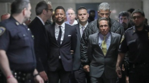 Cuba Gooding Jr., third from left, is escorted handcuffed as he arrives in court to face sexual misconduct charges, Tuesday Oct. 15, 2019, in New York. Gooding Jr. pleaded not guilty to an indictment alleging two instances of sexual misconduct. The new charge involves an alleged incident in October 2018. The defense paints it as a shakedown attempt. (Bebeto Matthews/AP)