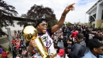 Toronto Raptors guard Kyle Lowry waves to fans holding the Larry O'Brien Championship Trophy during the 2019 Toronto Raptors Championship parade in Toronto on June 17, 2019. The Toronto Raptors announced Tuesday they have signed guard Kyle Lowry to a contract extension. Per team policy, financial terms of the deals were not disclosed. THE CANADIAN PRESS/Frank Gunn